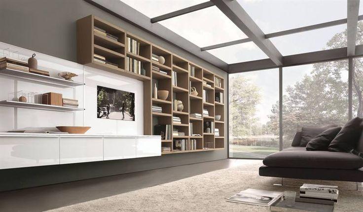 Een thuisbib in landelijk interieur met een houten boekenkast.© Misura Emme