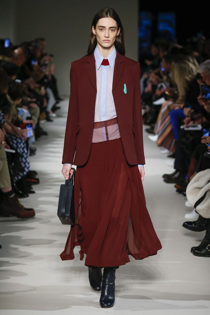 #VBAW17 Victoria Beckham Single Breasted Wool Jacket in Bordeaux worn with Pleated Sheer Skirt in Bordeaux, Patch Pocket Shirt in Pastel Blue, Heel Calf Leather Boots in Navy and Vanity Cross Body Handbag.