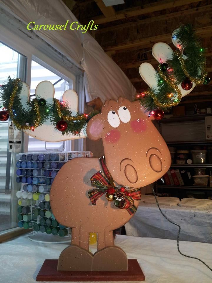 Cute wood moose.  Big enough for the porch.  There is greenery with lights and shiny Christmas balls in the antlers.  This was a pin that I liked so much that I turned it into a Wood Craft
