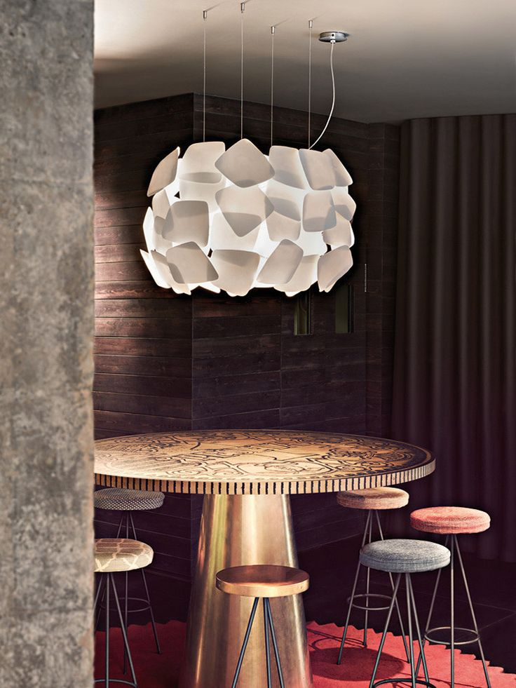 La Granja design studio designed the Biscuit pendant for Modiss.  Made with dozens of layered modular organically shaped porcelain pieces it plays with opacities to create a moody ambience.  Made in Barcelona.