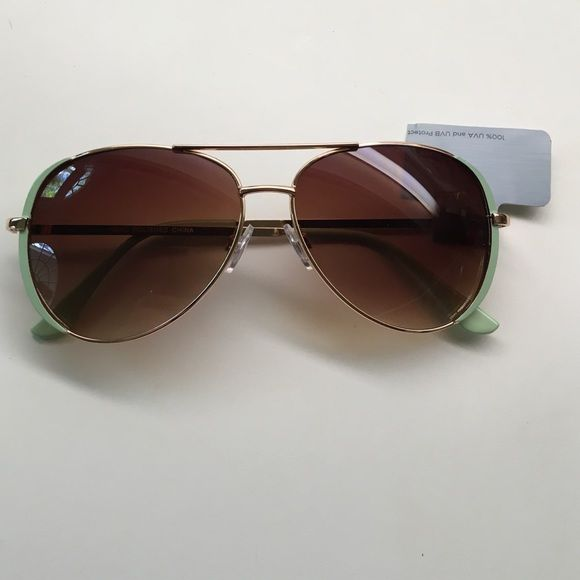 87f1179585ce Shop Women s Target Gold Green size One Size Sunglasses at a discounted  price at Poshmark. Gold and mint green.