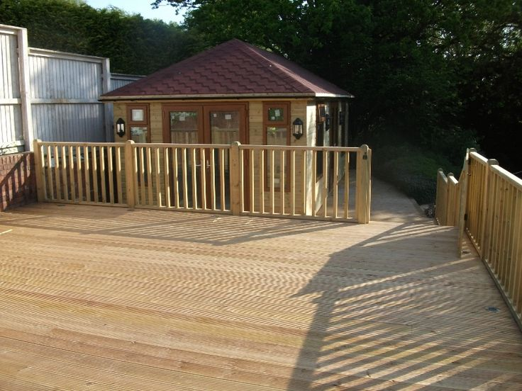 Tanalised timber decking area, spindles, hand rail & Summerhouse,   Davies Timber Wales Ltd