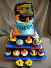 Construction Pals Cupcake Tower for a first birthday.  Smash cake with a 2d fondant decorated sugar cookie for the birthday boy.