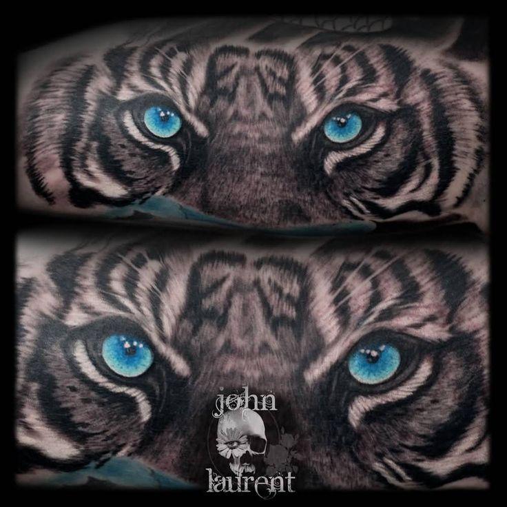 Blue Tiger Eyes Tattoo Idea by John Laurent