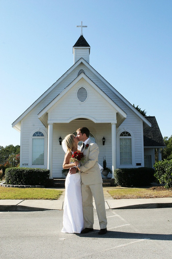 Wedding Photography of Bride and Groom in front of their small church where they got married on the coast of North Carolina.