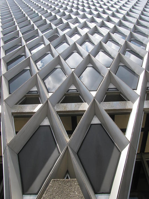 PATTERN. A pattern is a decorative design. The steel mullions creates a diamond shape pattern that is repeated throughout the entire facade.