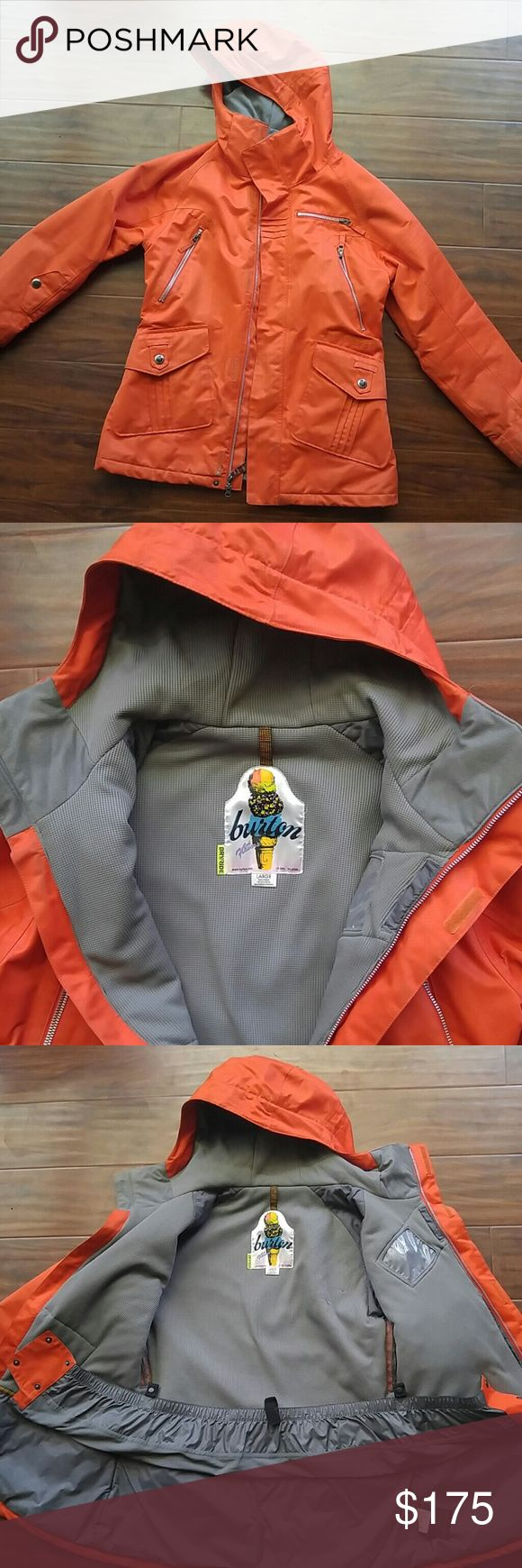 Womens Burton snowboard jacket Orange Burton snowboarding jacket. Size large. Thermal interior. Very warm. Waterproof. Slight staining on arm cuffs. Snow skirt. Many zipper pockets Burton Jackets & Coats