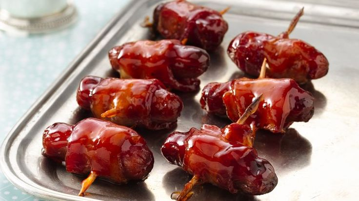 A sweet and savory sauce coats mini bacon-wrapped sausages. It's a crowd-pleasing snack!