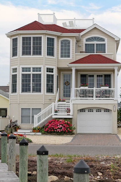 A relaxing ocean view, ample natural sunlight and private dock highlight this traditional New Jersey beach house