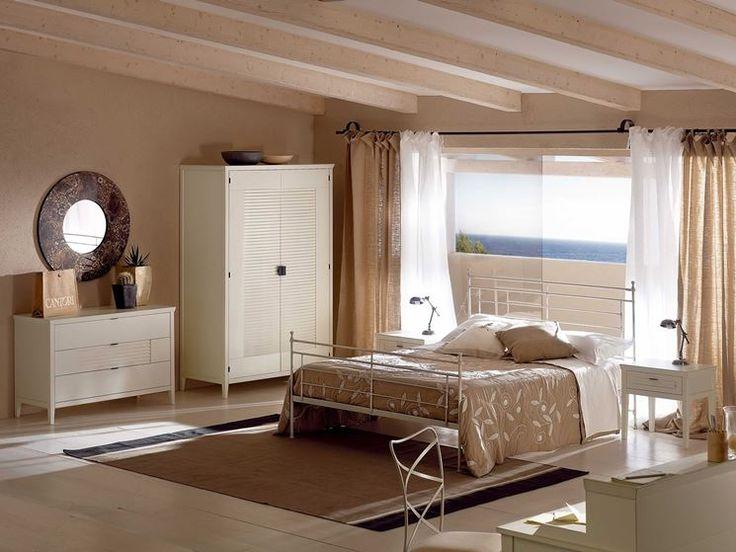 camera da letto cantori nei toni del tortora: color tortora abbinabile a tonalità di grigio e marrone, oltre che al bianco = atmosfera calda e rilassante
