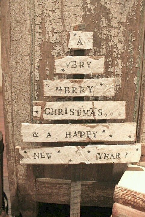 Houten kerstboom met tekst.