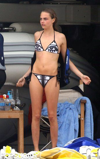 Cara Delevingne in a cool black-and-white triangle bikini....get something like it at American apparel