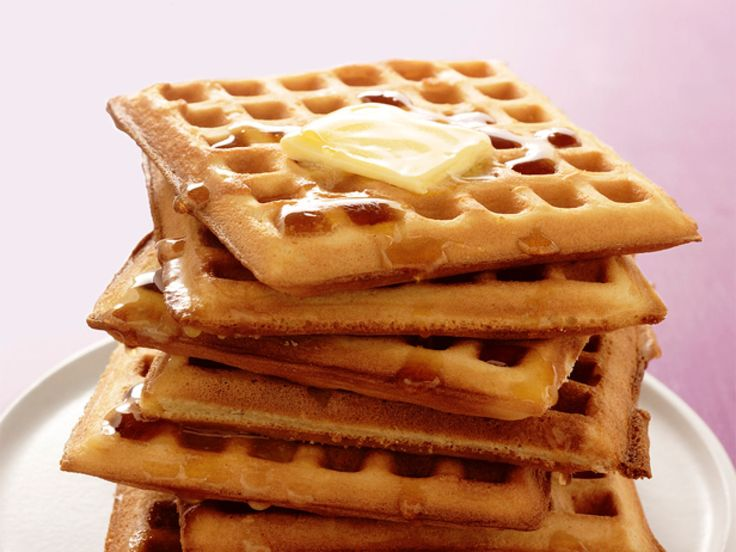 Classic Waffles : Whisk 2 cups flour, 4 teaspoons baking powder, 2 tablespoons sugar and 1 teaspoon salt. Mix in 2 eggs, 1 1/2 cups milk, 5 tablespoons melted shortening and 4 tablespoons melted butter. Cook in a waffle iron until crisp.