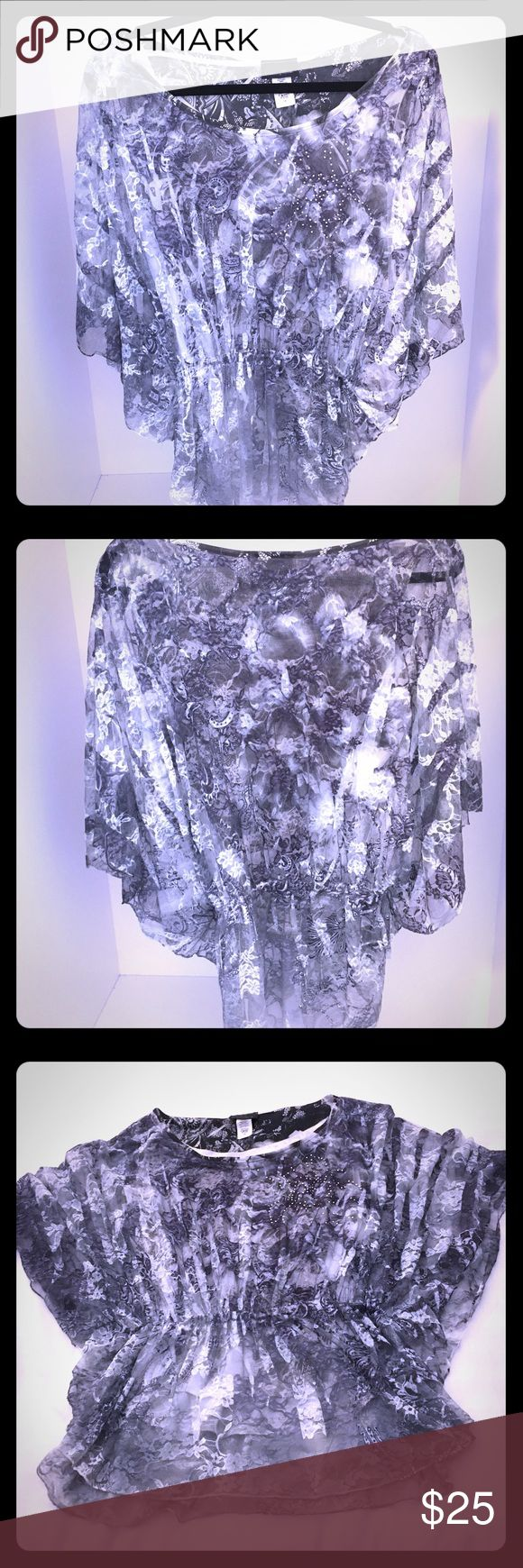 """Fifty Shades of Gray This beautiful Brittany Black """"Fifty Shades of Gray"""" floral lace batwing top is embellished with rhinestones on the front. It is white and black and has many different shades of gray. 92% Nylon 8% spandex. Has a 100% Polyester white and gray floral liner tank top underneath that you can see in pictures 5, 6 & 7. Size 1X. NWOT. Never worn. No flaws with this top!!! Brittany Black Tops Blouses"""