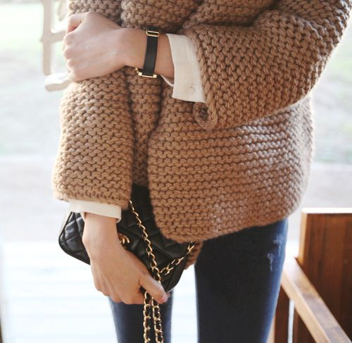 Easy cold weather elegance can be found in this sweater's oversized knit and wider sleeves, ideal against the white blouse and feminine black watch & Chanel-style cross body bag.