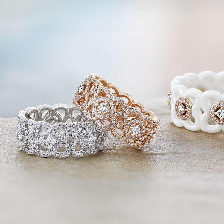 The signature De Beers Enchanted Lotus collection is a sparkling tribute to the serenity of the lotus flower. These Enchanted Lotus Bands in white gold, rose gold and contemporary white ceramic create unfurling petals with lines of micropavé diamonds. #diamondmastery #thehomeofdiamonds #debeerslondon