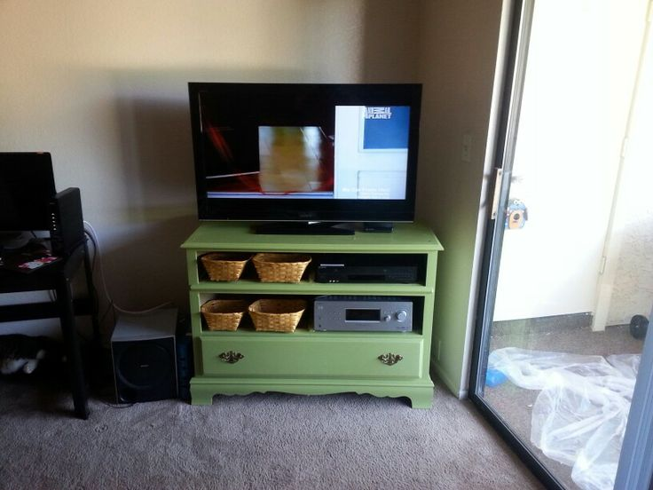 My new dresser turned entertainment center add paint, baskets take out two drawers and you got a cheap entertainment center