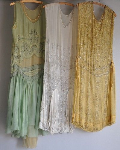 1920's dresses. I adore the mint green and peach one on the left, but I'm pretty sure it'd look like a huge baggy sack on me.