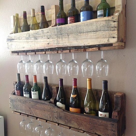 Made out of %100 reclaimed wood, this piece is sure to catch attention in your house for it's unique and one of a kind style. One rack is left natural and the other has a stain mix to darken the wood. If you wood like both dark please let us know. Style meets full functionality with this wine rack holding 10 wine bottles and up to 9 long stem wine glasses. This will vary depending on the style of glass you wish to display. Because it is made of reclaimed pallet wood, not every board will be…