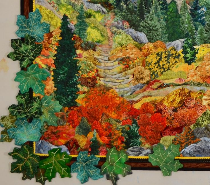 Leaves escaping over border of award winning landscape quilt. www.kathymcneilquilts.com