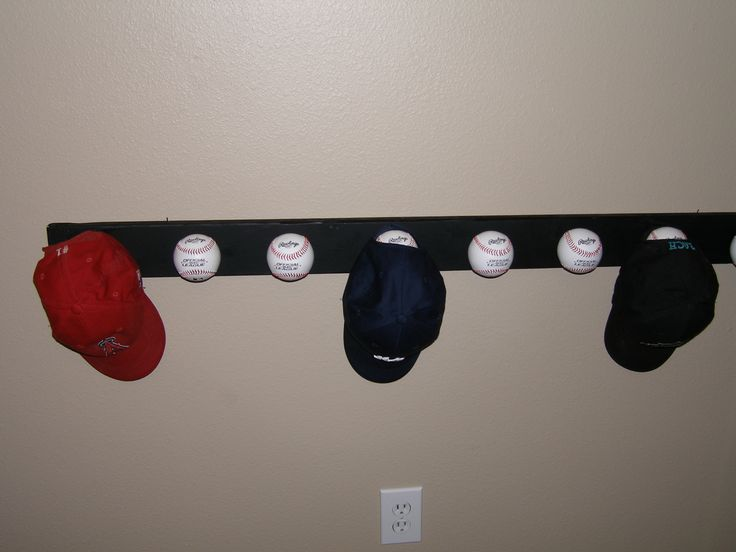 Another idea for hanging Mike's hats. Baseball hat rack...paint a 1x4, attach baseballs with screws from the back.  Maybe I can attach hooks to an old bat.