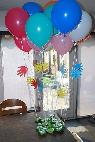 Afscheidstraktatie peuters: knijpfruit aan een ballon.