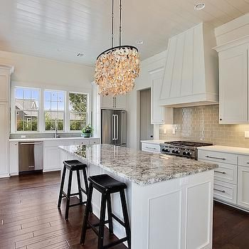 Gorgeous Kitchen Features White Cabinets Paired With White Quartz  Countertops And A Gray Subway Tiled Backsplash.