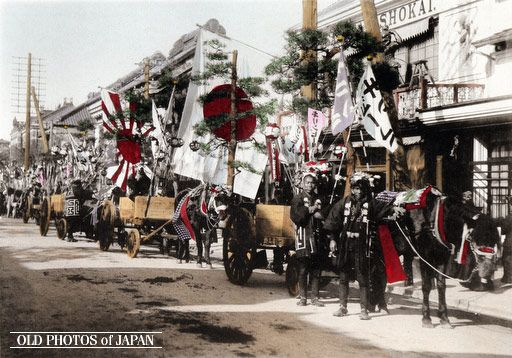 Kobe, 1906. Merchants display their wares in a New Year cart procession, one of the few New Year customs in this series that can not be seen anymore. This image is part of The New Year in Japan, a book published by Kobe-based photographer Kozaburo Tamamura in 1906.