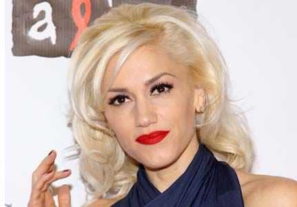 I stood next to Gwen Stefani in line at the ticket booth at Universal Studios in California! She's so short...had on her bright red lipstick too!
