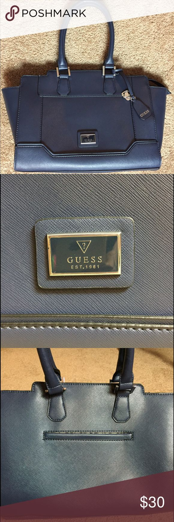 Navy blue Guess handbag Navy blue Guess handbag with silver detail. Brand new, worn only once and in great condition. Guess Bags