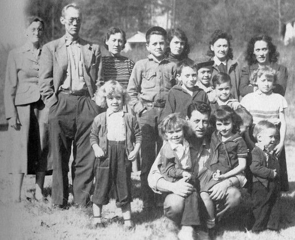 Avie Lee Parton in an undated photograph with, in front row, Bobby, left, Denver, Dolly, Willadeene and Randy. Back row: Cassie, left, cousin Donna Faye, Stella, David. (Estelle Watson/ Family Archives.)