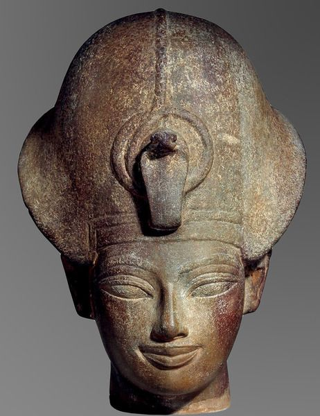 Bust of King Amenhotep III wearing the blue crown, dim: 24 x 20 x 16 cms, quartzite. New Kingdom, 18th Dynasty, ca.1350 BC. Now in the British Museum. EA30448