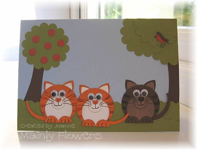 Uses circles for the cats and scalloped circles for the tree tops. Clever!