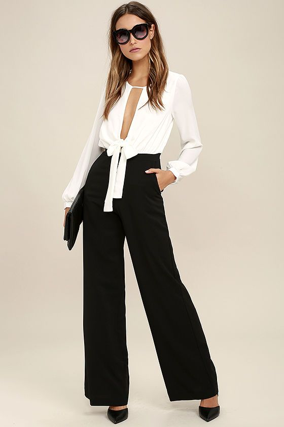 The Overjoyed Black and White Jumpsuit is the total package for a special night out! A long sleeve woven poly top, with an open front and back and tying waist, transitions into black wide-leg trouser pants with side seam pockets. Hidden back zipper.