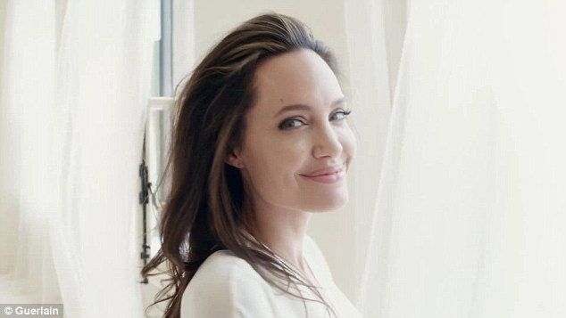Breathe in: Angelina Jolie stepped back in front of the lens to help launch a new perfume from Guerlain which is inspired by her