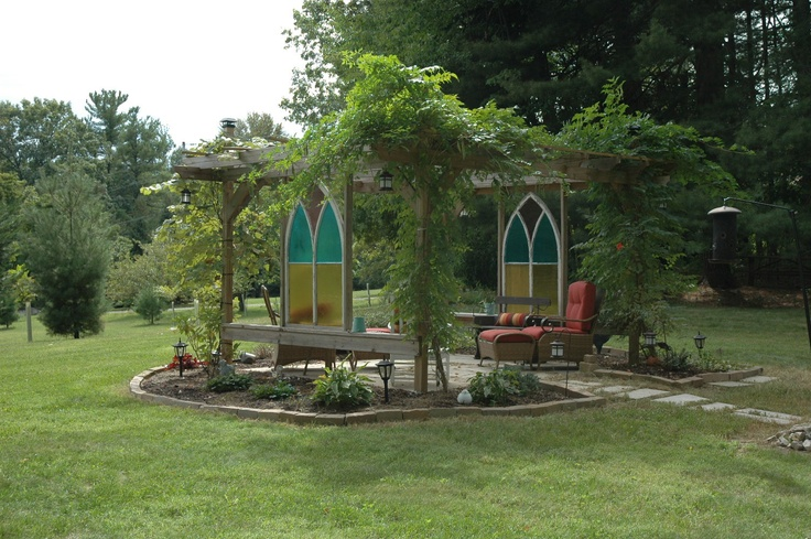 Our pergola made using old church windows bought at a yard sale.