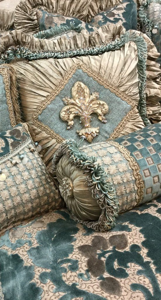 The Paradise Collection by Reilly-Chance Collection combines a Soft Blue Chenille with Taupe Silk for a look that is Calming. The Box-pleated Dust skirt is accented with a silk ruffle and decorative trim. The Decorative Pillows are accented with beads, fringes and a Large Fleur de Lis that is covered in Swarovski Crystals! Our over sized bedding is designed to fit the larger beds of today with ample drop on both the duvet and the dust skirt.