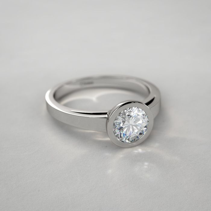 Contemporary Bezel-Set Round Solitaire Engagement Ring in 14k White Gold
