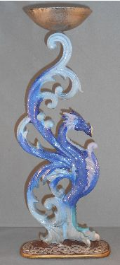 Blue Dragon Candle Holder from Absolute Angels This funky blue candle holder is of a mythical dragon with the candle holder held aloft by the dragons wings  £7.99