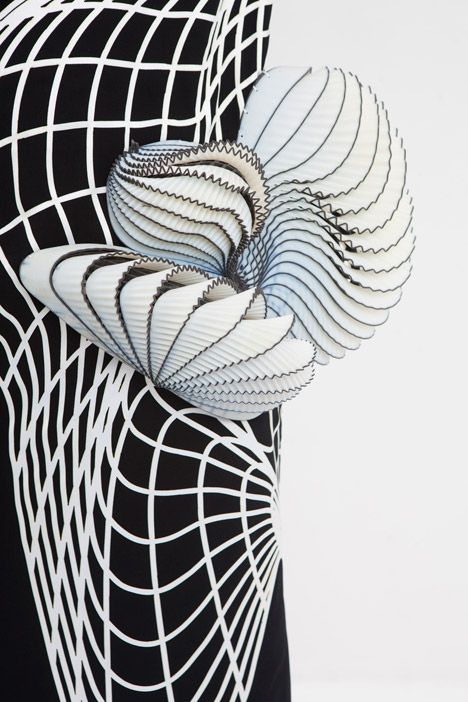 Garments influenced by distorted digital drawings featuring 3D-printed elements.