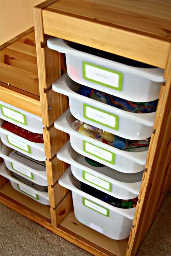 "More Trofast from Ikea: ""In the lower unit we keep paper, painting supplies, coloring books, etc. All labeled so everyone knows where to find things. White paper in one bin, construction paper in another.....it is so well organized that it actually ends up staying that way, which is pretty miraculous around here!"""