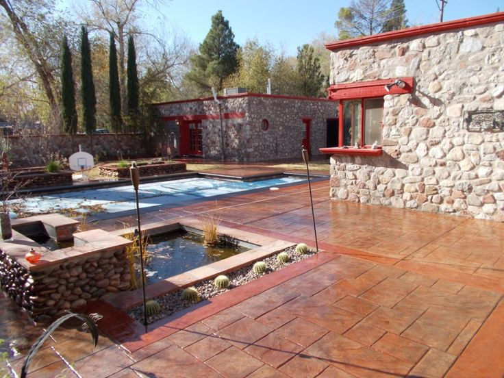 Landscape and Concrete Impressions, stamped concrete, retaining walls, stone work, outdoor kitchens, landscape, concrete, sod installation, trees and shrubs, outdoor fire features, outdoor water features, landscaping design, acid stain, sprinkler install
