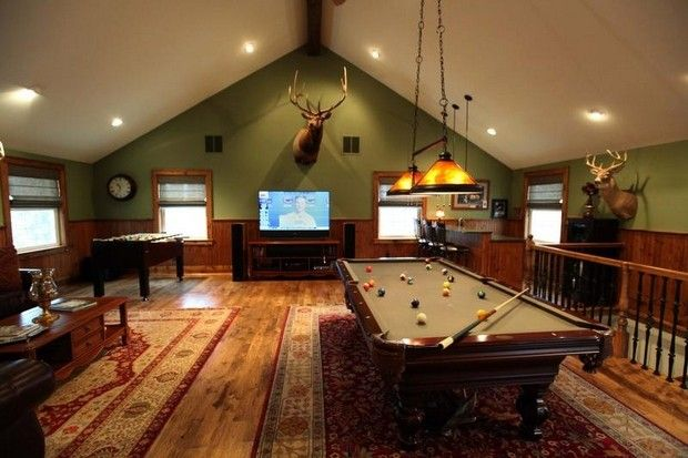 A pool table takes center stage in a 750 square foot for Garage game room
