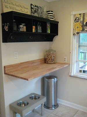 floating butcher block- from Ikea, mounted on wall brackets. Neat Idea. Something like this might be nice in our kitchen one day!