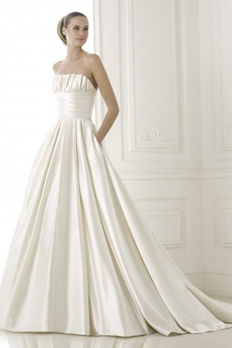 Similar to the Melissa Sweet silk wedding gown with crumb catcher neckline