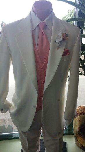 Ivory tuxedo with coral vest and tie.  Www.jalanformalwear.com