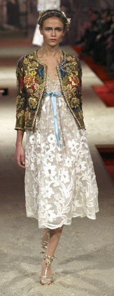 Christian Lacroix...love, love, love the tapestry jacket with the lace dress.  The only thing I may change is the color of the waist ribbon.