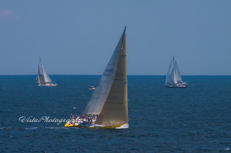 sailors dreams- Sailing from Marblehead to Halifax, A sunny day with haze in the distance and sailboats racing away
