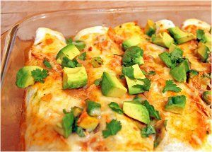 This Mexican chicken enchiladas recipe for Avocado Chicken Enchiladas is a flavor sensation. The Mexican chicken cooks in its well-seasoned juices for 8 hours, and when it's done, wrap it in flour tortillas with your favorite toppings.