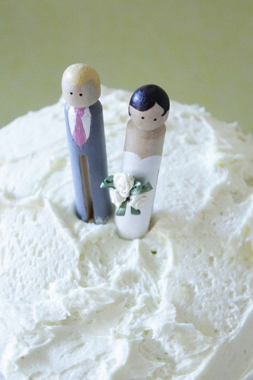 DIY Peg Cake Toppers. These are too cute! I'd do this if I weren't using a family heirloom already as a topper!
